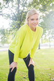 Active smiling blonde pausing after a run Stock Photos
