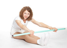 Active smiling young woman doing sport exercises Royalty Free Stock Images
