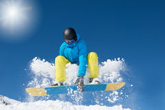 Active snowboarder jumping. In winter mountains Stock Photo