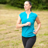 Active sport girl runs outdoor through forest Royalty Free Stock Photo