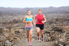 Active sport people runners on trail running path Stock Photo