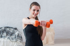 Active sportive athletic woman boxing dumbbells Royalty Free Stock Photo