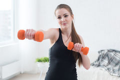 Active sportive athletic woman boxing dumbbells Royalty Free Stock Photos