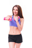 Active sportive athletic woman with dumbbells pumping up muscles biceps Stock Photography