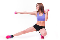 Active sportive athletic woman with dumbbells pumping up muscles biceps Royalty Free Stock Photos
