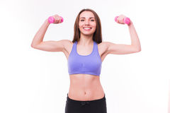 Active sportive athletic woman with dumbbells pumping up muscles biceps Stock Photos