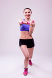 Active sportive athletic woman with dumbbells pumping up muscles biceps Royalty Free Stock Images