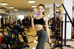 Active sportive athletic woman with dumbbells pumping up muscles biceps concept fitness sport training. Lifestyle Royalty Free Stock Photography