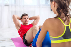 Active sportive man doing abdominal exercises Stock Photos