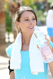 Active sportive woman drinking water Stock Photo