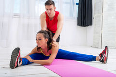 Active sportive woman stretching her legs and back Stock Photo