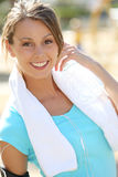 Active sportive young woman drinking water Stock Images