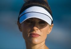Active sports woman in fitness clothes against blue sea royalty free stock image