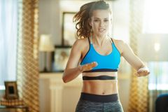 Active sports woman workout and using heart rate monitor