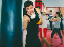 Active sportsman in the boxing hall practicing boxing punches wi Stock Photo
