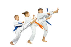 Active sportsmens in karategi are beating punch mae-geri Royalty Free Stock Photos