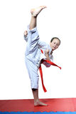 Active sportswoman beats circular a blow mawashi geri Stock Photography