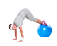 Active sportswoman with blue ball Stock Photo