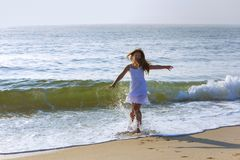 beautiful girl runs along the beach in a summer vacation royalty free stock photo