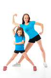 Active sporty girls. Two little sporty girls isolated on white stock photo