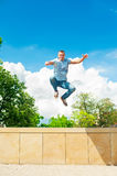 Active sporty lifestyle. Athletic jumping man. Blue sky backgrou Stock Photo