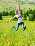 Active sporty woman jumping outdoors Stock Image