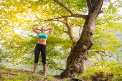 Active sporty woman relaxing in beautiful nature. Royalty Free Stock Photography