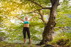 Active sporty woman relaxing in beautiful nature. Stock Photo