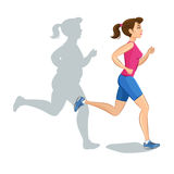 Active sporty young jogging woman, loss weight cardio training. Royalty Free Stock Image