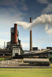 Active steel mill smelter emiting billowing toxic fumes Stock Photography