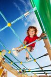 Active strong boy on playground Royalty Free Stock Photo