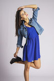 Active student girl in blue dress stock photography