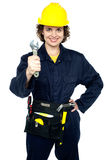 Active team woker holding spanner in hand Royalty Free Stock Images