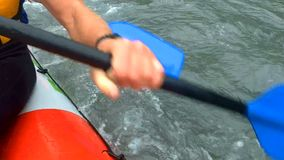 Active teamwork leading rafting team to victory in exhausting competition. Stock footage stock video footage