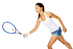 Active tennis woman. Slim fit asian woman holds out her tennis racket to return serve in a rally Stock Photos