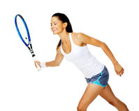 Active tennis woman. Happy asian woman holds out her tennis racket in forehand stroke to return a rally Stock Images