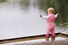 Active Toddler In Puddle Royalty Free Stock Photos