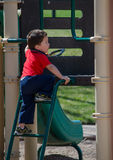 Active toddler on playground Stock Image
