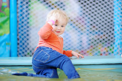 Active toddler at playground Stock Photo