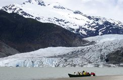 Active Tourism. Active people explore Mendenhall Glacier on a small boat in Juneau, Alaska Royalty Free Stock Photography