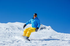 Active tourist. On the snowboard Royalty Free Stock Image
