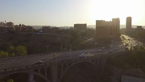 Active traffic in city, cars driving across bridge, transport infrastructure. Stock footage stock video footage