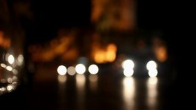 Active traffic on the road at night in background stock footage