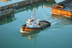 Active Tug and Loading Barge Stock Images