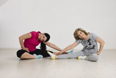 Active  two women doing gymnastic Stock Images