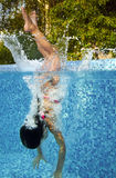 Active underwater child jumps to swimming pool Royalty Free Stock Photos