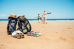 Active vacation concept image. Backpacker travelers family happy. To swim in ocean waves Stock Images