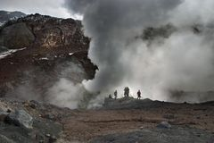 Active volcano. People inside active volcanic crater, Kamchatka Royalty Free Stock Photo