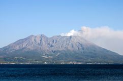 Active volcano. And volcanic plume facing the sea called Sakurajima in Kagoshima, Japan Stock Photos