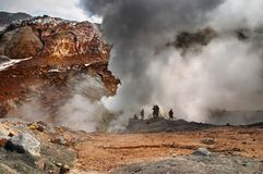 Active volcano. People inside active volcanic crater, Mutnovsky volcano, Kamchatka Royalty Free Stock Image